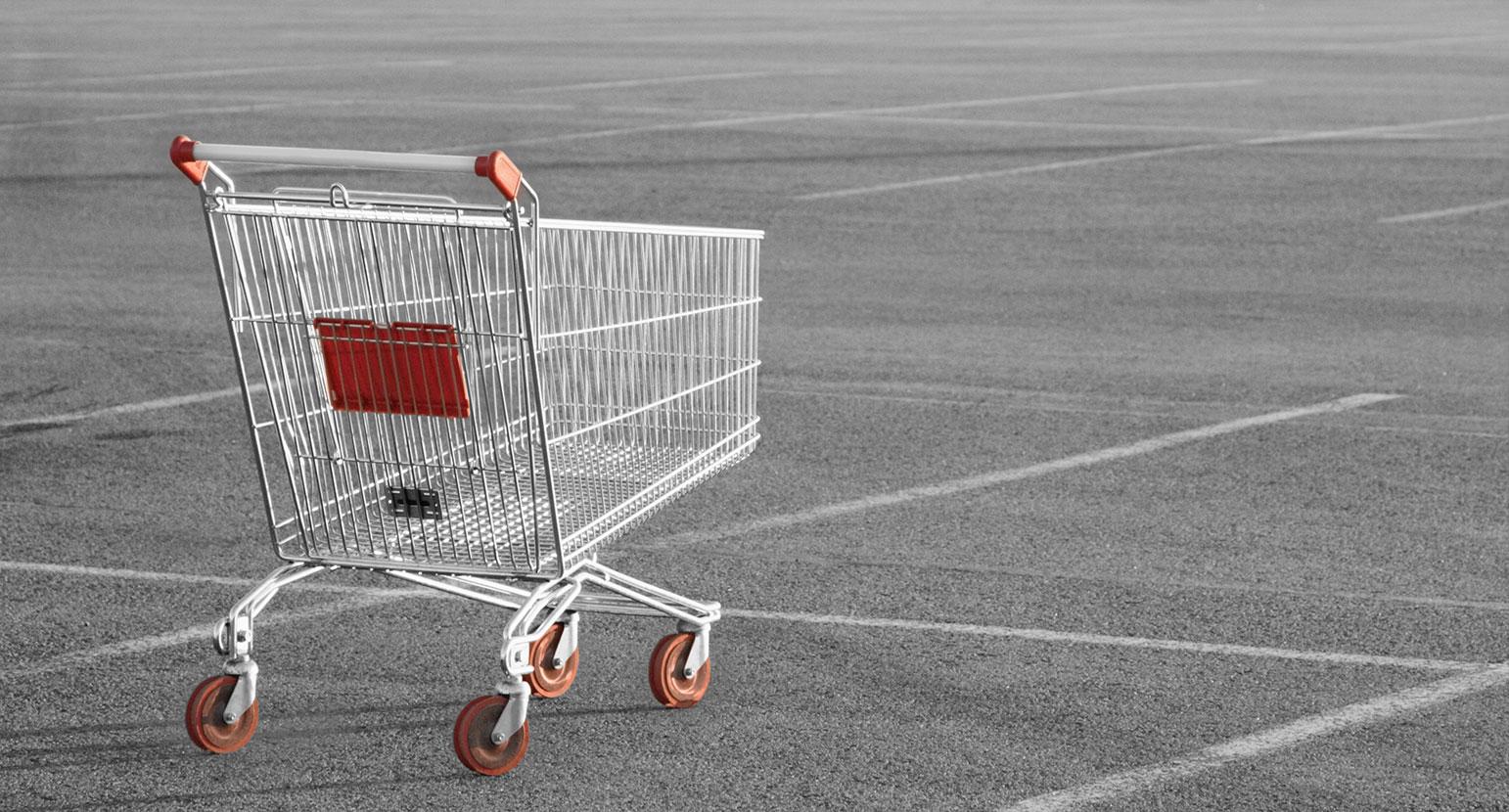 Aussie Retailers empty trolley in empty carpark
