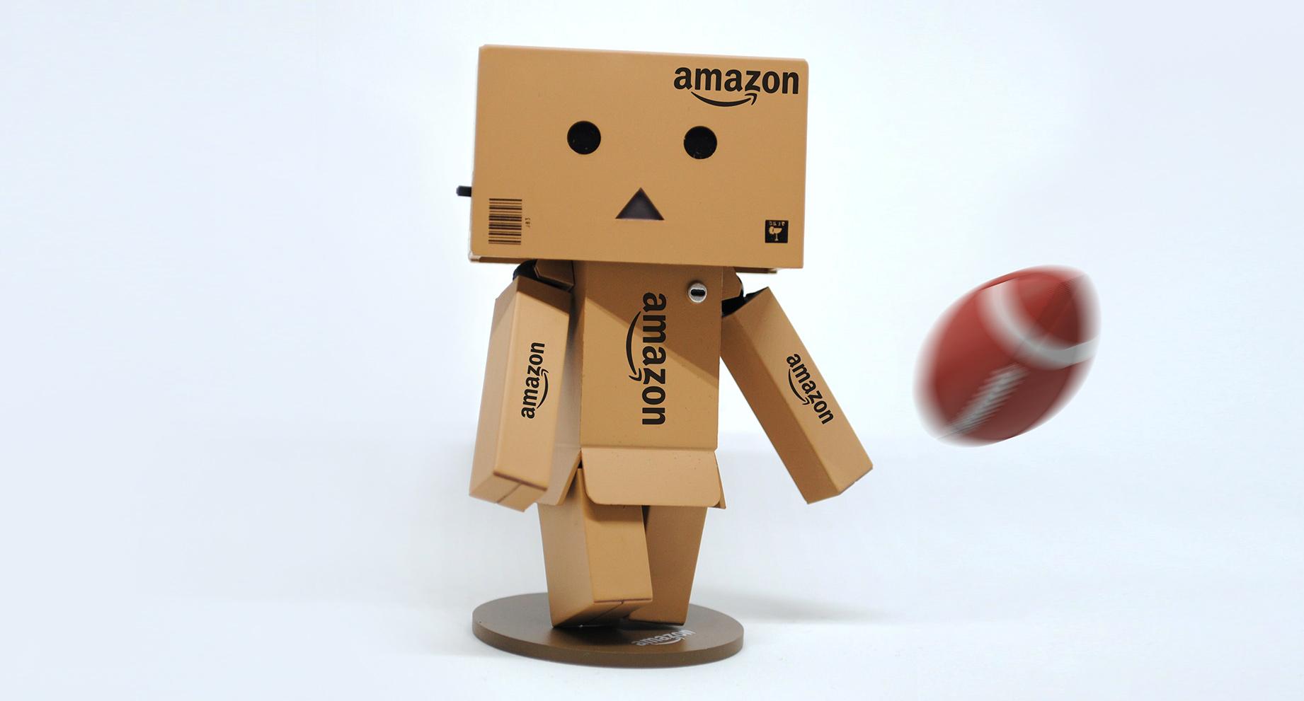 Amazon box character kicks NRL football