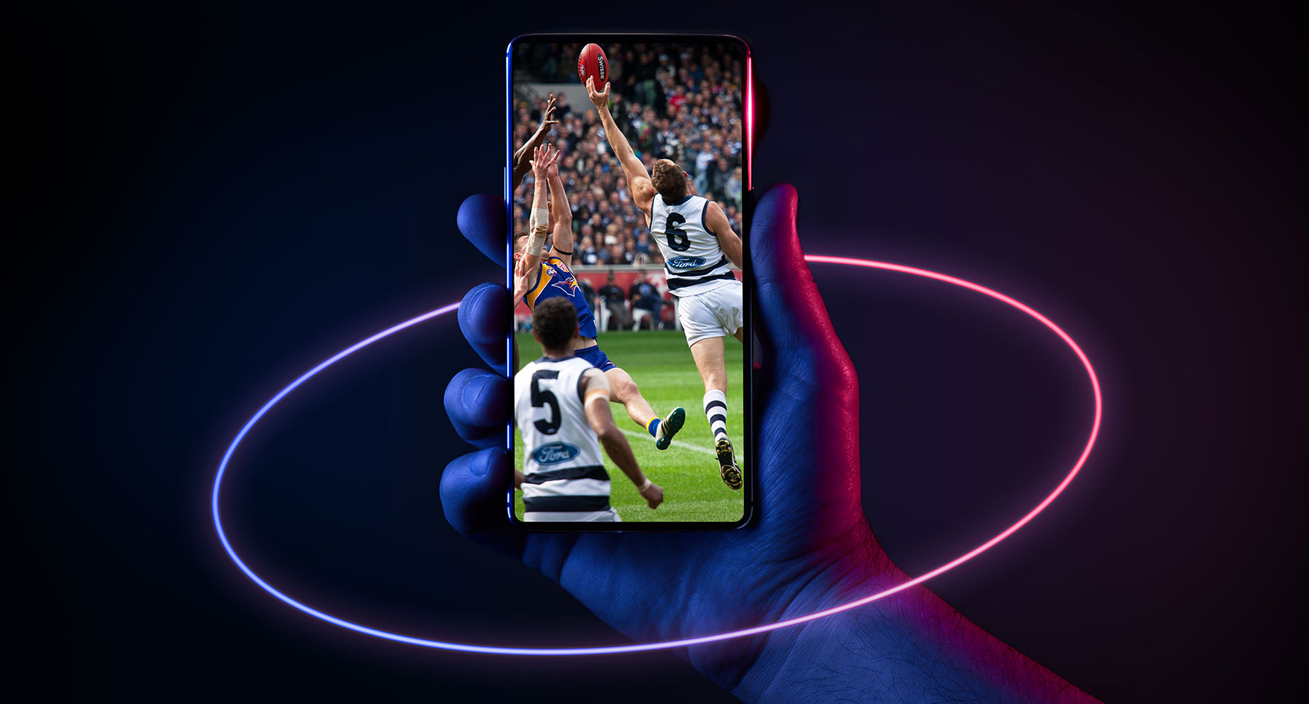 Hand of power holding phone streaming AFL football