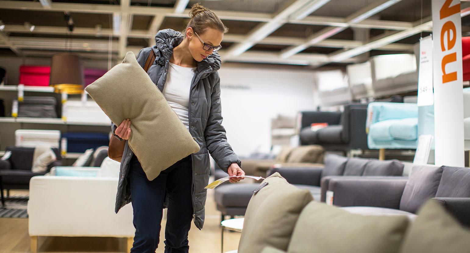 Woman shops at furniture shop