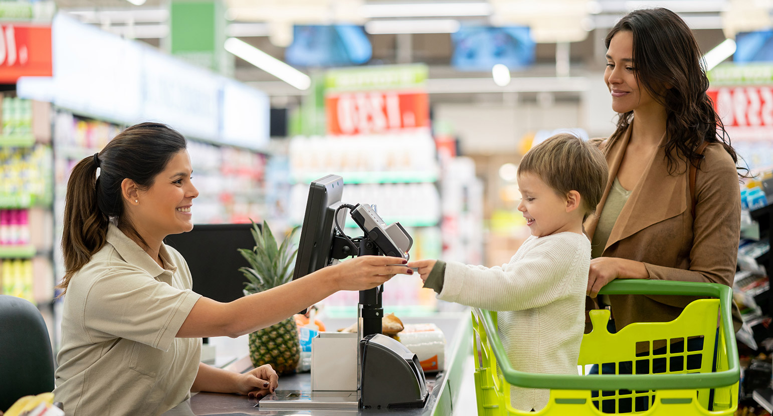 Mum and son at cash register